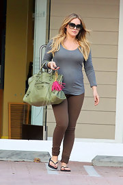Hilary Duff kept comfy in a pair of brown skinny jeans and a snug gray tee.