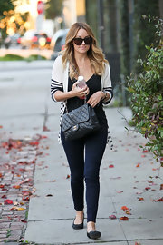 Lauren Conrad embraced a timeless nautical look by layering a chic striped cardigan over her dark separates.