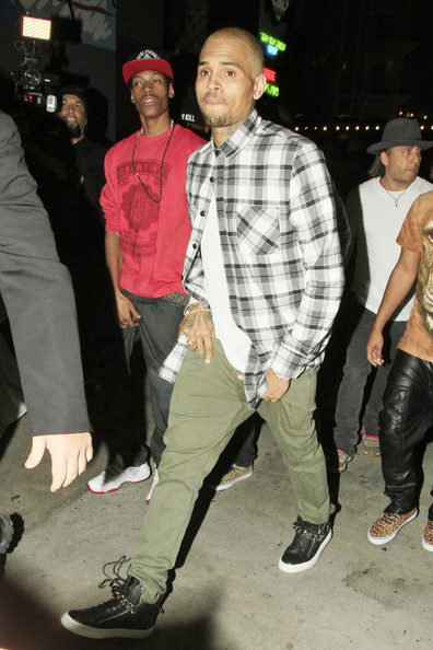 Chris Brown was photographed in a pair of classy leather sneakers as he celebrated his birthday with friends.