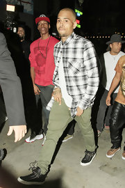 Chris Brown wore a casual plaid black and white button down as he celebrated his birthday at different hotspots in Los Angeles.