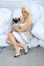 While in Las Vegas, Holly Madison posed for a photo wearing black and beige peep toe pumps.