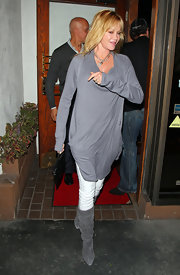 Melanie Griffith's knee-high suede boots matched her oversized gray knit well.