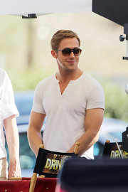 Despite his oversized shades, Ryan Gosling couldn't hide his amusement as he hung around the set of 'Drive.'