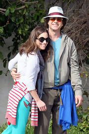 Susan Downey completed her walking ensemble with a chic pair of round sunnies.