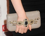 Have you ever seen a clutch so rough yet refined? We love this juxtaposition of ladylike gems and rocker studs!