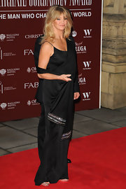 Goldie dons a black evening dress with an attached shawl for the Gorby 80 Gala in London.