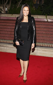 Tia Carrere polished off her simple yet elegant QVC look with a black frame clutch.