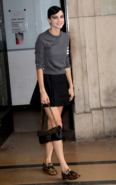 Jessica Stam styled her outfit with a fun-looking pair of animal-print loafers.