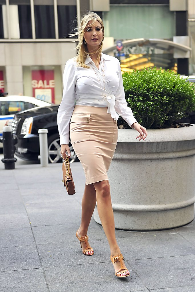 5a9d05d06eff87 Ivanka looks oh so sophisticated in this white wrap collared blouse and  nude pencil skirt.