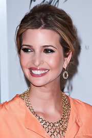 Ivanka Trump swept on a sheer rose-colored lip gloss for an appearance at Lord & Taylor.