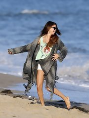 "Selena Gomez frolicked on the beach in her ombre gray ""Tristan Fringed Blanket Cardigan."""