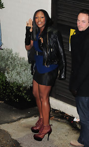 Alexandra Burke toughened up her look with unique tan ankle boots trimmed with burgundy leather.