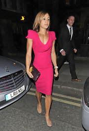 Jessica Ennis accented her architectural sheath with a plum envelope clutch with a gold medallion.