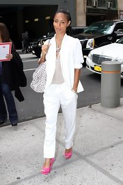 Jada Pinkett Smith added a cheery pop of color to her all white ensemble with a bright pink pair of peep toe pumps.