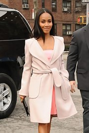 Jada Pinkett Smith looked soft and feminine as she arrived at New York Fashion Week in a light pink wool coat.
