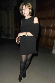 Kate Silverton looked giddy in a little black dress as she attended a birthday party in London.