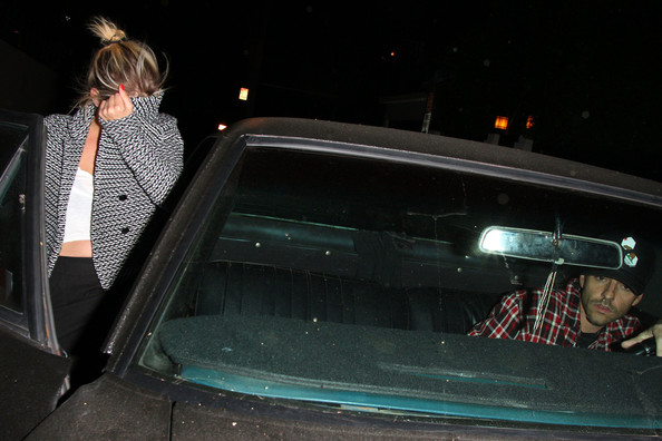 PRETTY LITTLE HIDER!! 'Pretty Little Liars' star Ashley Benson who is rumored to be dating actor James Franco seen hiding her face from photographers while leaving with a male friend from the Chateau Marmont in Hollywood