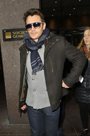 James Franco greeted friends in style with this navy blue patterned scarf.
