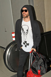 Jared Leto opted for a casual zip-up hoodie for his totally relaxed travel look.