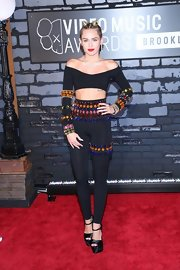 Miley's long-sleeve jeweled crop top and matching leggings had a cool '80s feel to them at the VMAs.