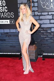 Ellie blended a feminine silhouette with a rocker edge with a stud-covered dress at the VMAs.