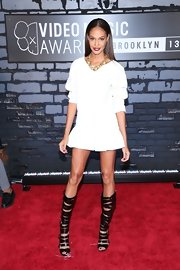 Joan Small stepped out in a flared mini dress that showed off her long legs and strappy gladiator sandals.