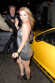 Sunny Lane stepped out in a pair of black fringed heels which went perfectly with her sparkly silver top at the Playboy Radio Summer Pajama Party.