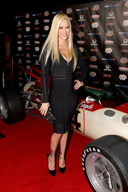 Jenna Jameson gave her sexy bodycon dress a girlish finish with black patent pumps with bow-adorned heels.