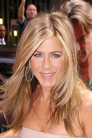 These diamond snake hoops were created especially for Ms. Aniston.