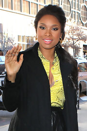 Jennifer Hudson headed out in NYC wearing her hair in a low side ponytail.