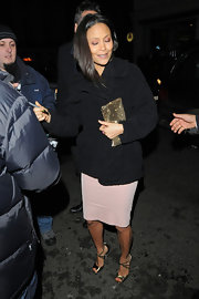 Thandie Newton covered up her pink cocktail dress with an equally classic black wool coat while out in London.