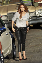 Jennifer Lopez showed off her famous curves in a pair of zipped leather pants.