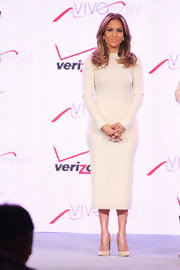 Jennifer Lopez looked sleek and sophisticated in a long-sleeve white fitted dress.