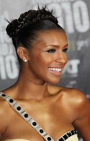 Melody was all smiles, sporting a tightly braided updo with tiny textured spikes.