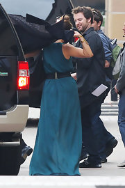 Jennifer Lopez cinched her waist in long teal dress with an elastic belt.