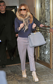 J. Lo paired her plaid cropped trousers with lace-up ankle boots.