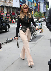 To give her look an added touch of classic style, J.Lo opted for a pair of nude slacks.