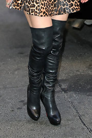 Jennifer Lopez paired her leopard look with over-the-knee black boots.
