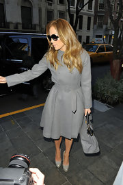 Jennifer Lopez looked refined and feminine in a flared gray wool Edisson coat with a waist-whittling belt.