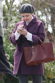 Ginnifer Goodwin opted for a purple wool coat with a black sash while on set of 'Once Upon A Time.'