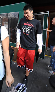 Basketball star Jeremy Lin left a bar in casual style, wearing red basketball shorts with a Nike T-shirt.