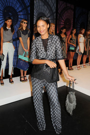 Joy Bryant accented her outfit with a fringed gray leather bag during the Charlotte Ronson fashion show.