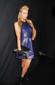 Paris Hilton topped off her edgy-chic ensemble with a black envelope clutch when she attended the Charlotte Ronson fashion show.