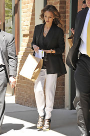 "Jessica looked sophisticated in an oversized blazer, tapered pants and wooden platform ""Zola"" sandals."