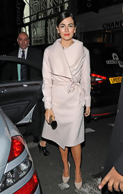 Camilla channeled Grace Kelly in this plush wool wrap coat for the Savatore party in London.