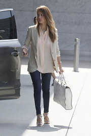 Jessica Alba polished off her ensemble with an ultra-elegant Valentino leather filigree tote.