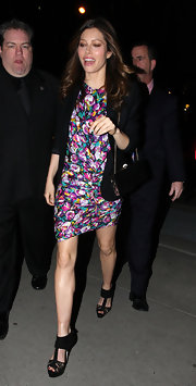 Actress Jessica Biel made her way into Tribeca Grand hotel wearing a flirty floral dress, ankle strap heels and a darling chain strap buckled evening bag.