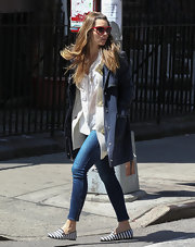 Jessica Biel chose a navy coat to pair over a cardigan and blouse for a cool layered look.