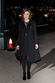 A radiant Keira Knightley layered a black military-style coat over her darling lace dress.
