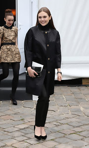 Elizabeth Olsen rocked and edgy black evening coat during Paris Fashion Week.